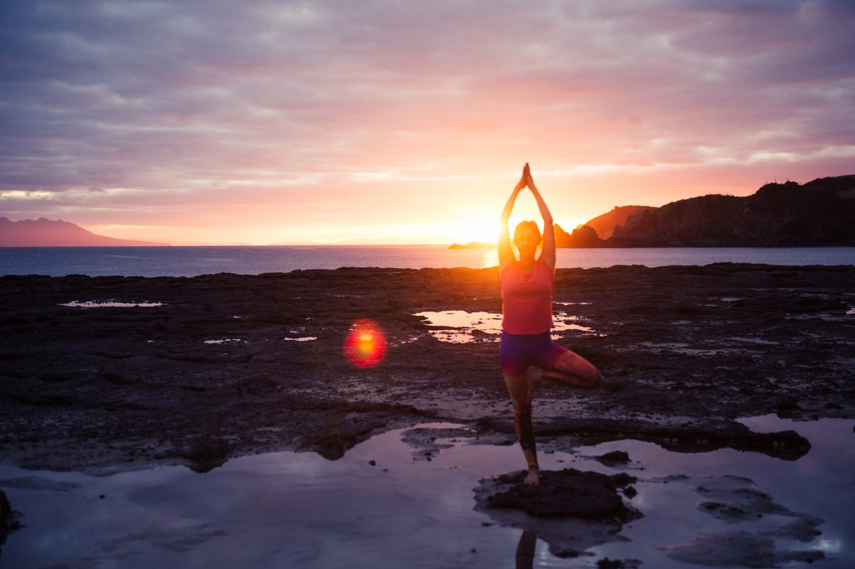 Sunrise photoshoot at the beach with Ingrid Yoga by lolamedia.co.nz
